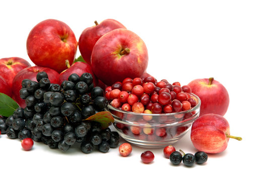chokeberry, red apples and cranberries on a white background