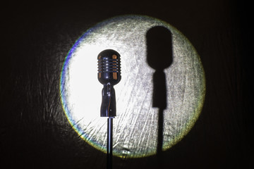 spotlight retro microphone on stage