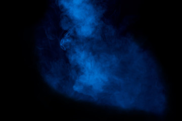 blue pattern of dark cigarette vapor on a dark background mystical and mysterious