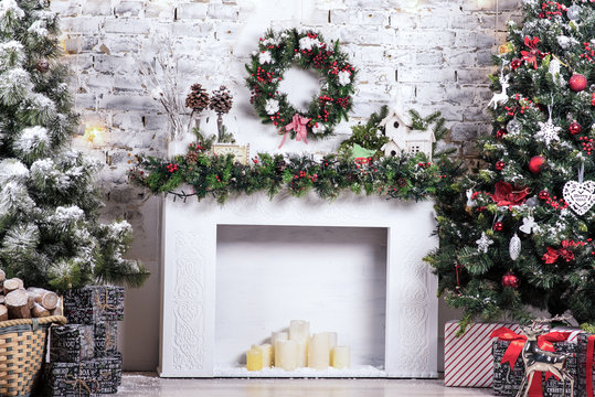 New Year decorated. Interior bright room with Christmas decoration. Fir-tree, gift boxes, fireplace decorated with garlands holiday. Celebration photo