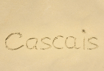 Inscription on wet sand Cascais.