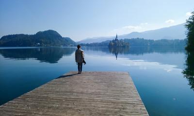 Girl  looking at lake Bled from wood bridge, Slovenia