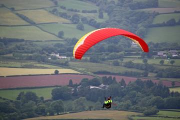 Fototapete - Paraglider flying wing