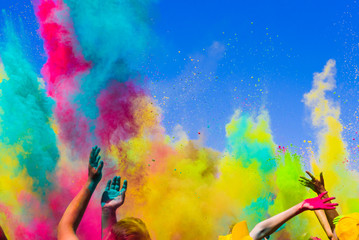 crowd throws colored powder at holi festival Wall mural