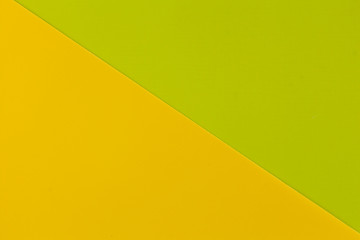 Wall Mural - Vibrant yellow and lime colored plastic surfaces jointed diagonally, background.