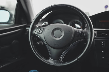 steering wheel, interior of a modern business car