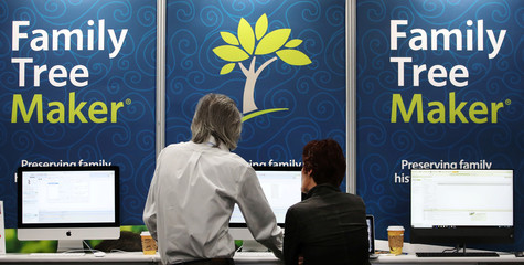 Attendees look at displays at the Family Tree Maker booth at the RootsTech annual genealogical event in Salt Lake City