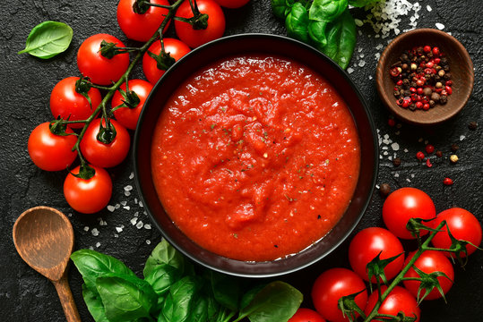 Homemade tomato sauce passata - traditional recipe of italian cuisine.Top view with copy space.