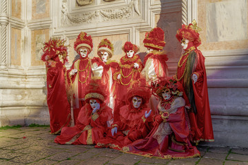 Venice, Italy Carnival mask and costume poses in Campo San Zaccaria.Masked persons in traditional costume pose at a Venetian square during the Venice 2019 Carnival.