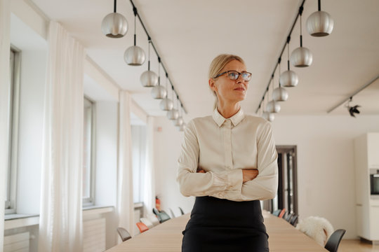 Confident businesswoman in conference room