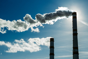 Smoking chimneys. The concept of air pollution and the environment. Damage to the atmosphere