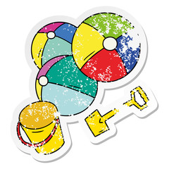 distressed sticker cartoon doodle beach balls with a bucket and spade