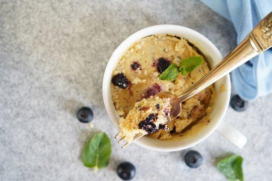 Homemade blueberry mug cake muffin, selective focus