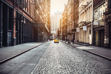Poster New York TAXI New York City Manhattan SoHo street at sunset time background