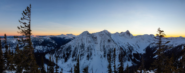 Beautiful panoramic Canadian Landscape View during a vibrant winter sunset. Taken on top of Zoa Peak near Hope, British Columbia, Canada.