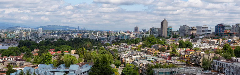 Aerial Panoramic view of the modern city during a cloudy summer day. Taken in Vancouver, British Columbia, Canada.