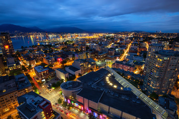 Downtown Vancouver, British Columbia, Canada - June 22, 2018: Aerial view of the modern city during night time after a cloudy sunset.