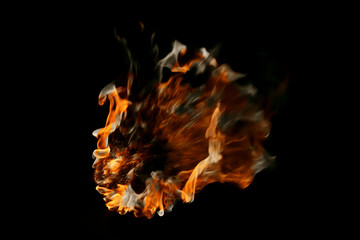 Flame and smoke on a black background.