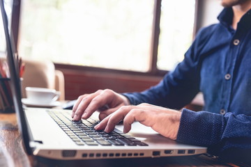 Man Working In Office And Typing On Computer Keyboard