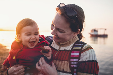 Mother and Baby Son Portrait, Outdoors in Spring Season at Seaside