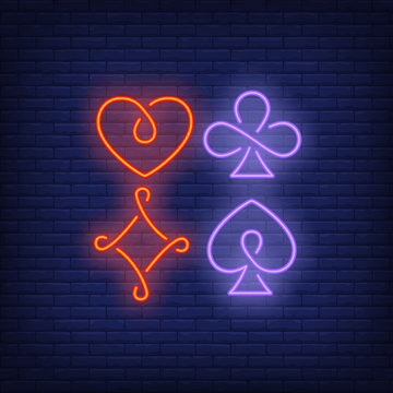 Four playing card suit symbols neon sign