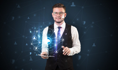 Secured cloud hologram on tablet  holded by spectacled young businessman in suit