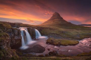 Kirkjufellfoss waterfall and Kirkjufell mountain on north coast of Snæfellsnes peninsula in Iceland