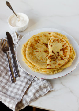 Norwegian potato pancakes Lefse in a white plate  on table. Traditional Scandinavian cuisine