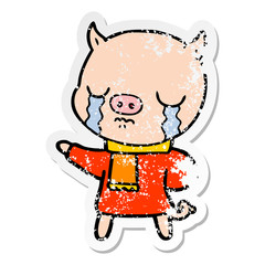 distressed sticker of a cartoon crying pig wearing scarf