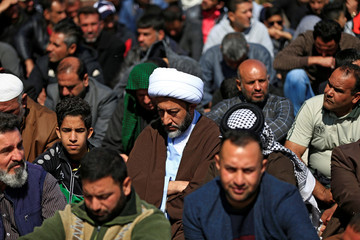 Supporters of Iraqi Shi'ite cleric Moqtada al-Sadr attend Friday prayers in Baghdad