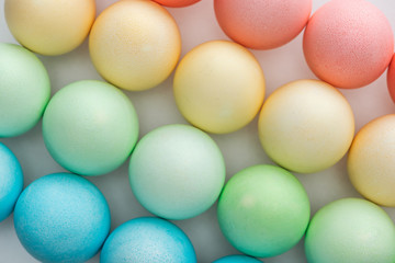top view of colorful painted easter eggs on grey