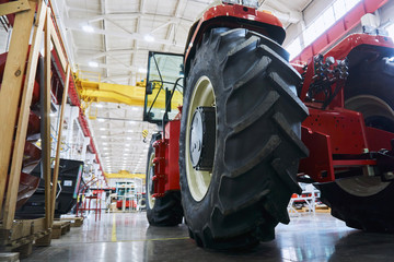 A number of modern tractors for agriculture are being finalized by workers at the final stage of production at a huge plant.