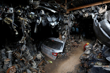 Car parts for sale are seen at a car junkyard on the outskirts of Jakarta