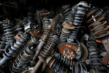 Used shock absorbers for sale are seen at a car junkyard on the outskirts of Jakarta