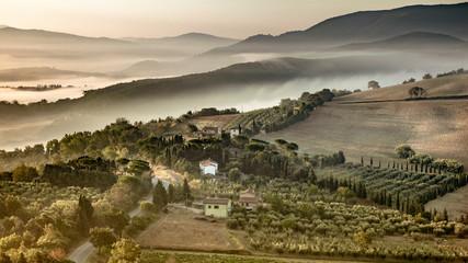 Tuscany foggy hills panorama view crop