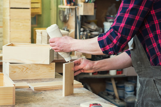 Worker making the wood box. Profession, carpentry and woodwork concept.