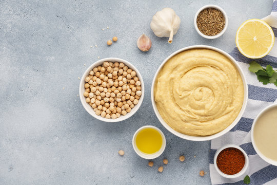 Bowl of hummus and ingredients for cooking.