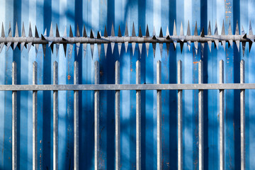 Security fence with sharp spikes