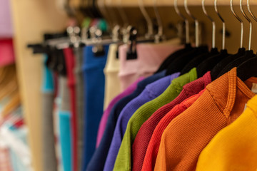 bright colored clothes on a rack