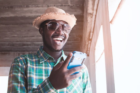 African man having fun with mobile