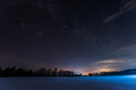 dark sky full of shiny stars in carpathian mountains in winter at night