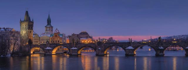 Fototapeta Beautiful panorama night view of Charles Bridge over Vltava river in Prague city,