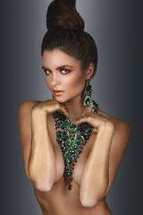 Sexy woman wearing big beautiful necklace with a lot of gems