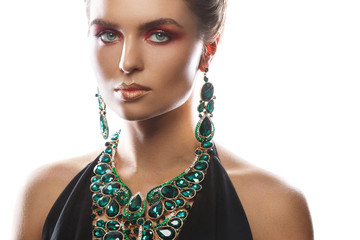 Sexy woman wearing big beautiful necklace and earrings with a lot of gems