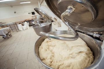 Keuken foto achterwand Bakkerij Making dough for bread in a kneader in a bakery