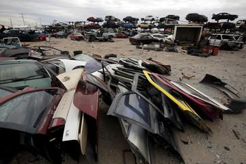 Car doors are seen at a junkyard in Ciudad Juarez