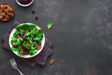 Spinach salad with  pecan nuts and cranberries