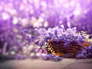 Lavender, lavender flowers in wicker basket on rustic table