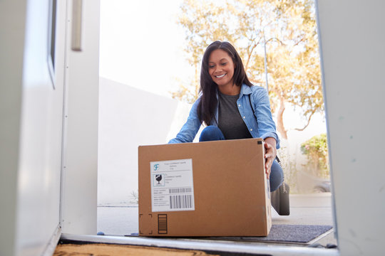 Woman Coming Back To Home Delivery In Cardboard Box Outside Front Door