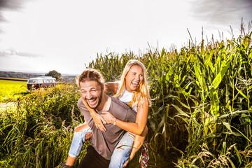 Carefree couple in cornfield